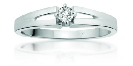 <em>14K Round Cut Diamond Ring; $449 </em>